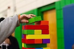 Child's hand building blocks